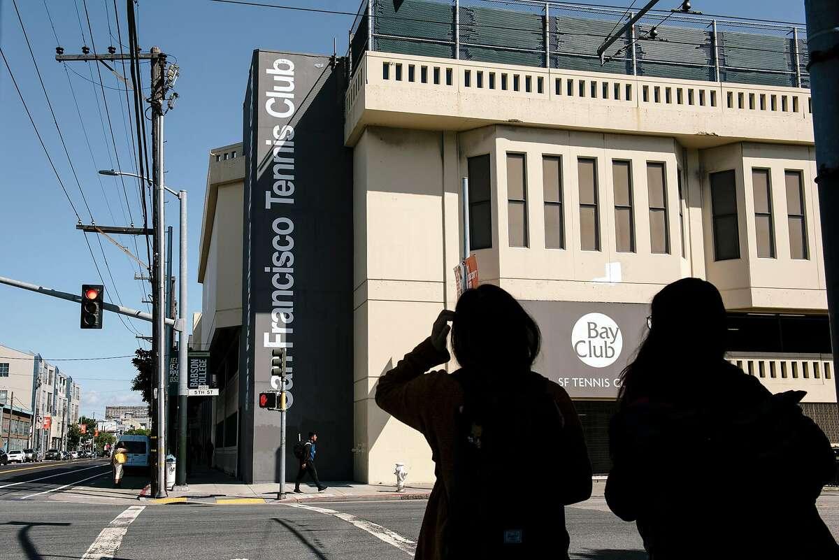 Pedestrians walk past the San Francisco Tennis Club in San Francisco, Calif, on Monday, September 30, 2019.