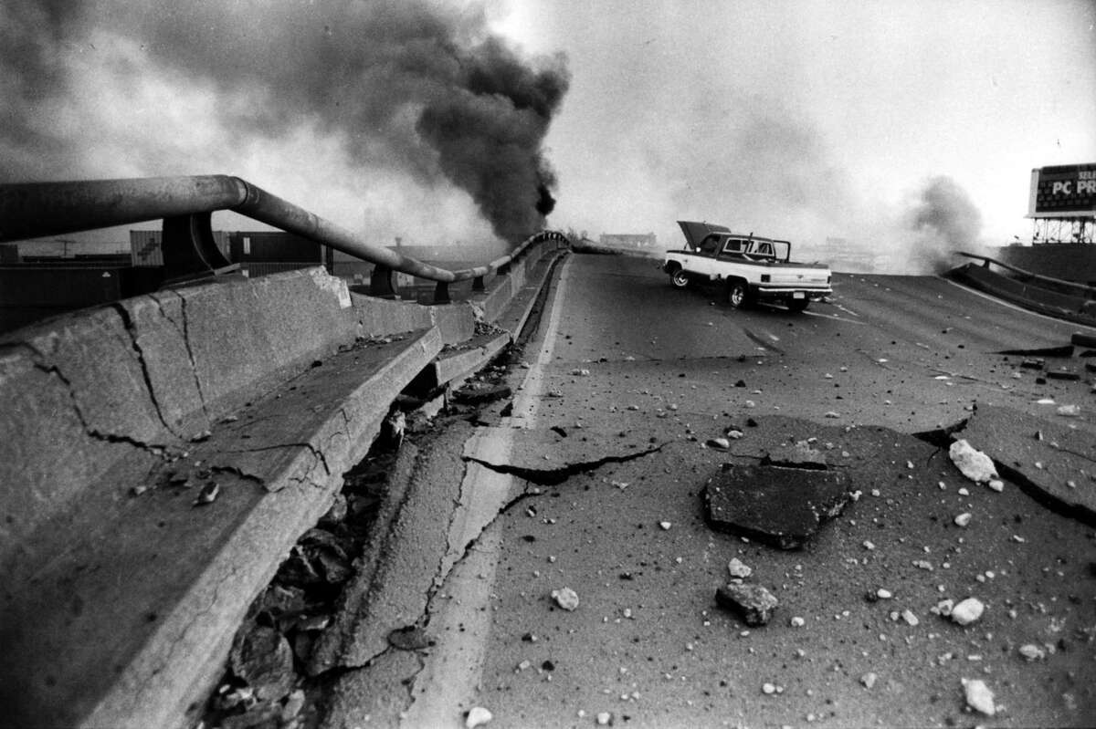 Apick up truck sits on the Cypress freeway in Oakland after it collapsed during the Loma Prieta earthquake.