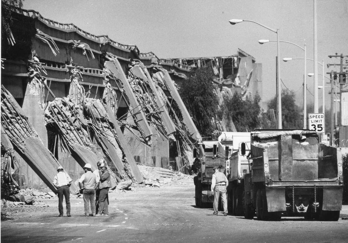 Caltrans workers inspect the Cypress structure portion of Interstate 880 in Oakland which collapsed when the Loma Prieta earthquake struck, October 17, 1989.
