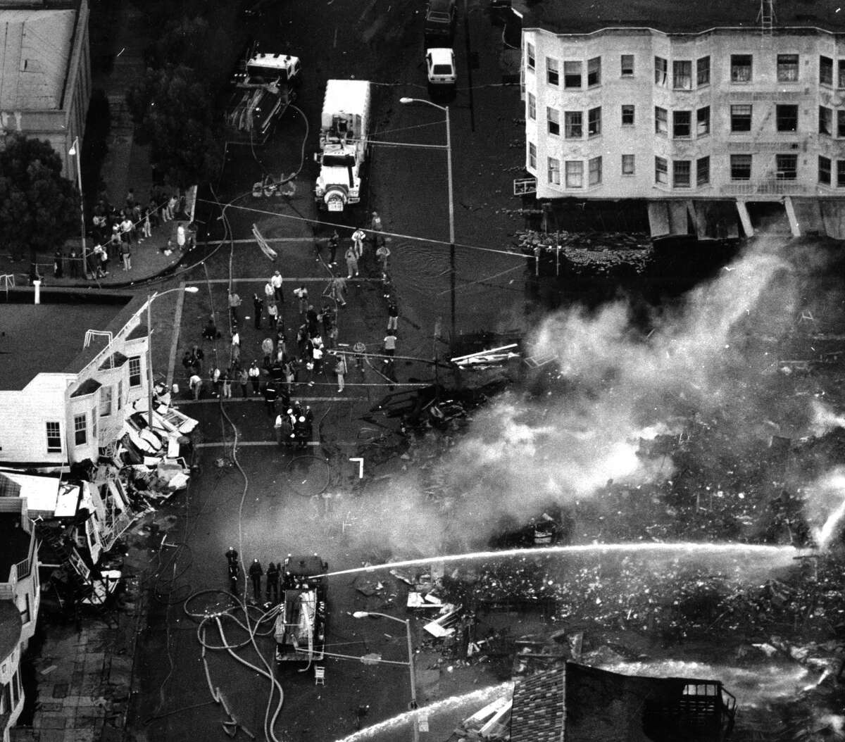 Firefighters try to contain fires in the Marina district after the Loma Prieta earthquake on October 19, 1989.