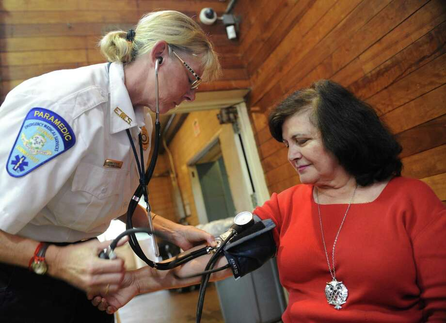 GEMS paramedic Lynn Ridberg checks the blood pressure of Riverside's Rose Revel at the Health & Wellness Expo at the Eastern Greenwich Civic Center in Old Greenwich last year. Dozens of vendors were on hand to provide information on services for seniors. Photo: Tyler Sizemore / Hearst Connecticut Media File Photo / Greenwich Time