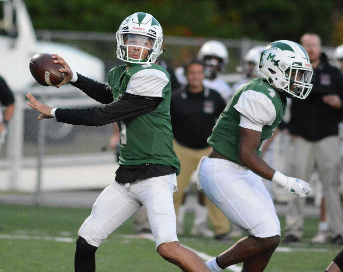 Maloney's James Tarver provides protection for quarterback Angel Arce Friday, Sept. 27, 2019 in the Spartans win over North Haven.