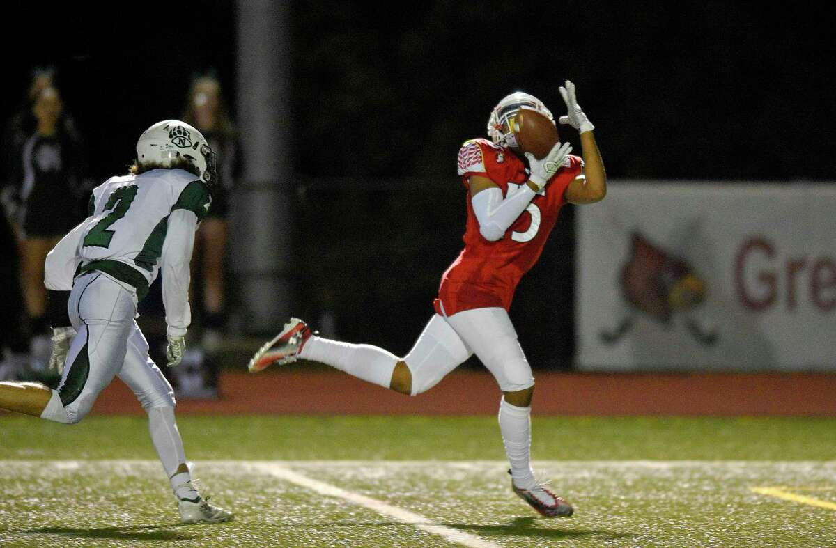 Greenwich's AJ Barber makes a reception that resulted in a Cardinal touchdown against Norwalk in the first half of an FCIAC football game at Cardinal Stadium in Greenwich, Conn. on Sept. 27, 2019.