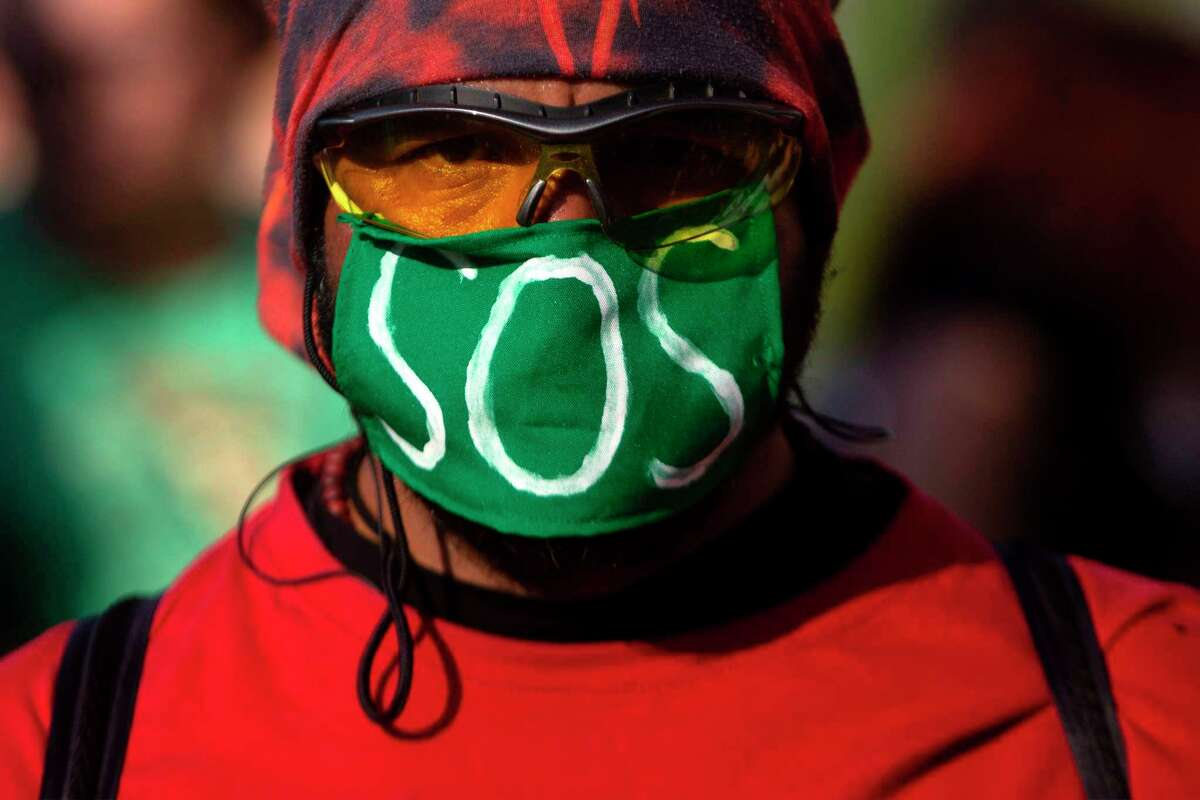 A masked demonstrator takes part in a global youth climate action strike in Santiago, on September 27, 2019, at the end of a global climate change week. (Photo by CLAUDIO REYES / AFP)CLAUDIO REYES/AFP/Getty Images