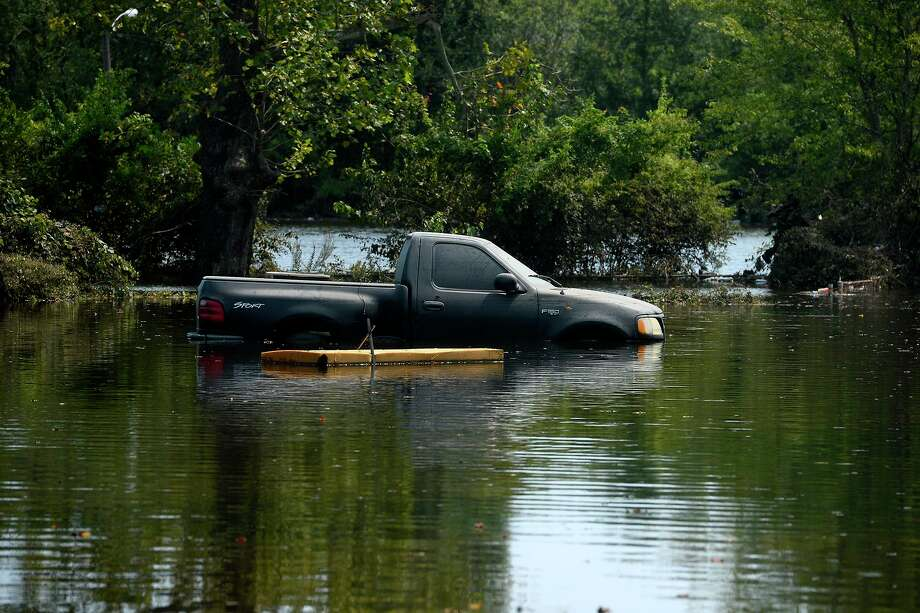A flooded truck remains stuck in water in the north end of Beaumont on Wednesday.  Photo taken Wednesday 9/6/17 Ryan Pelham/The Enterprise Photo: Ryan Pelham / Ryan Pelham/The Enterprise / ©2017 The Beaumont Enterprise/Ryan Pelham