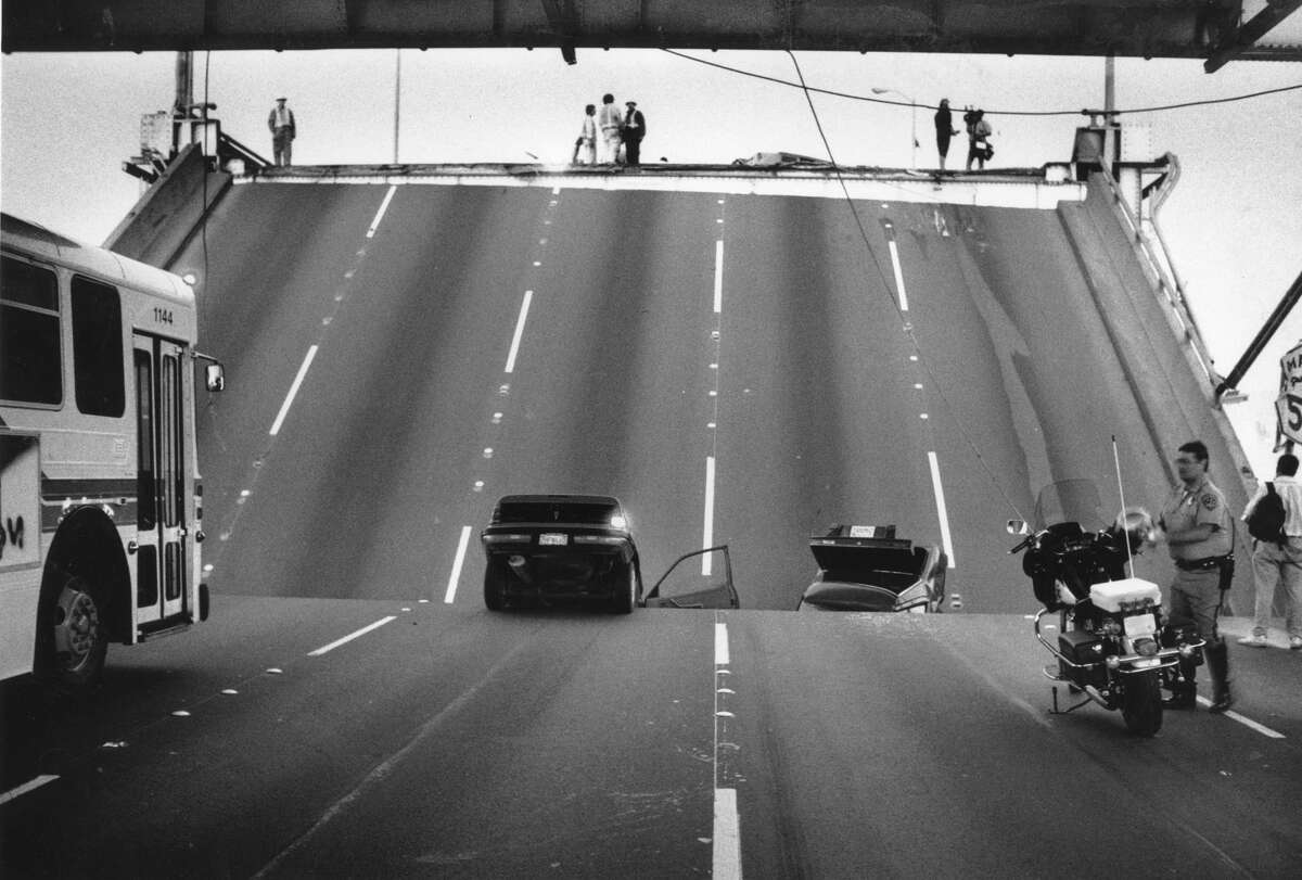 Caltrans workers and California Highway Patrol try to keep order, as a section of the Bay Bridge collapsed when the Loma Prieta earthquake struck, October 17, 1989.