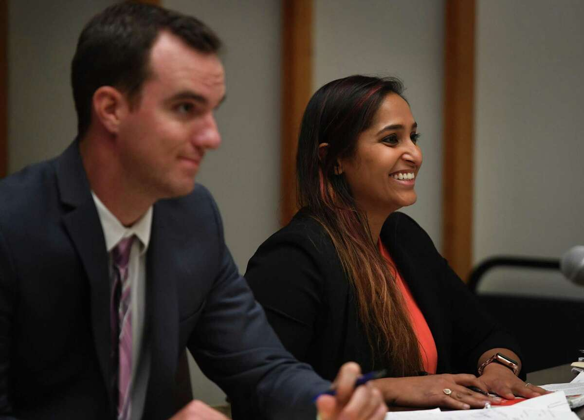 Attorneys for the plaintiffs Brian Ward, left, and Prerna Rao smile after Judge Barry Stevens denies the motion to dismiss their lawsuit to overturn the recent Bridgeport Mayoral Primary in Superior Court in Bridgeport, Conn. on Monday, September 30, 2019.