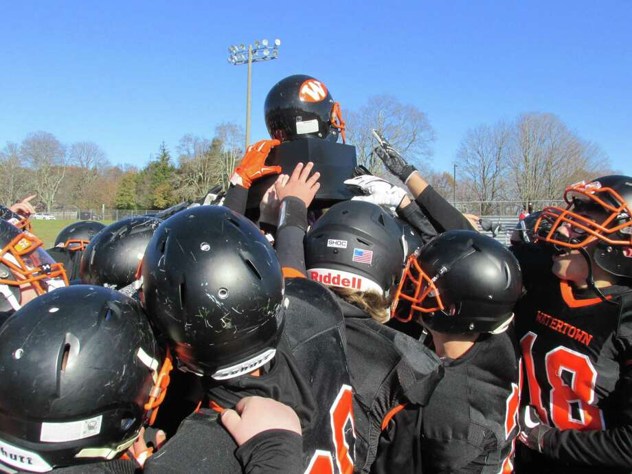 Watertown hoisted The Helmet after its win over Torrington in the annual Thanksgiving Day rivalry game in 2017. Photo: Peter Wallace / For Hearst Connecticut Media