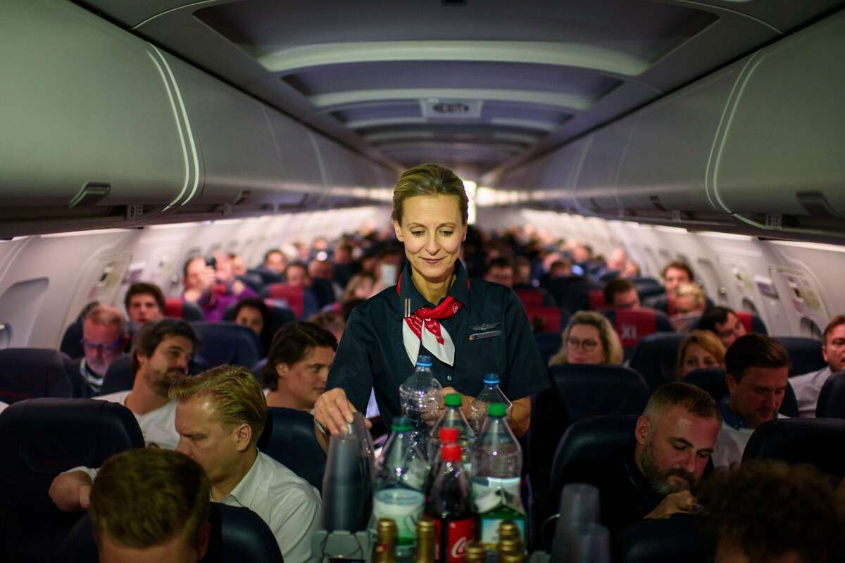 An Air Berlin steward serves drinks on a flight to Berlin, Germany in October of 2017.