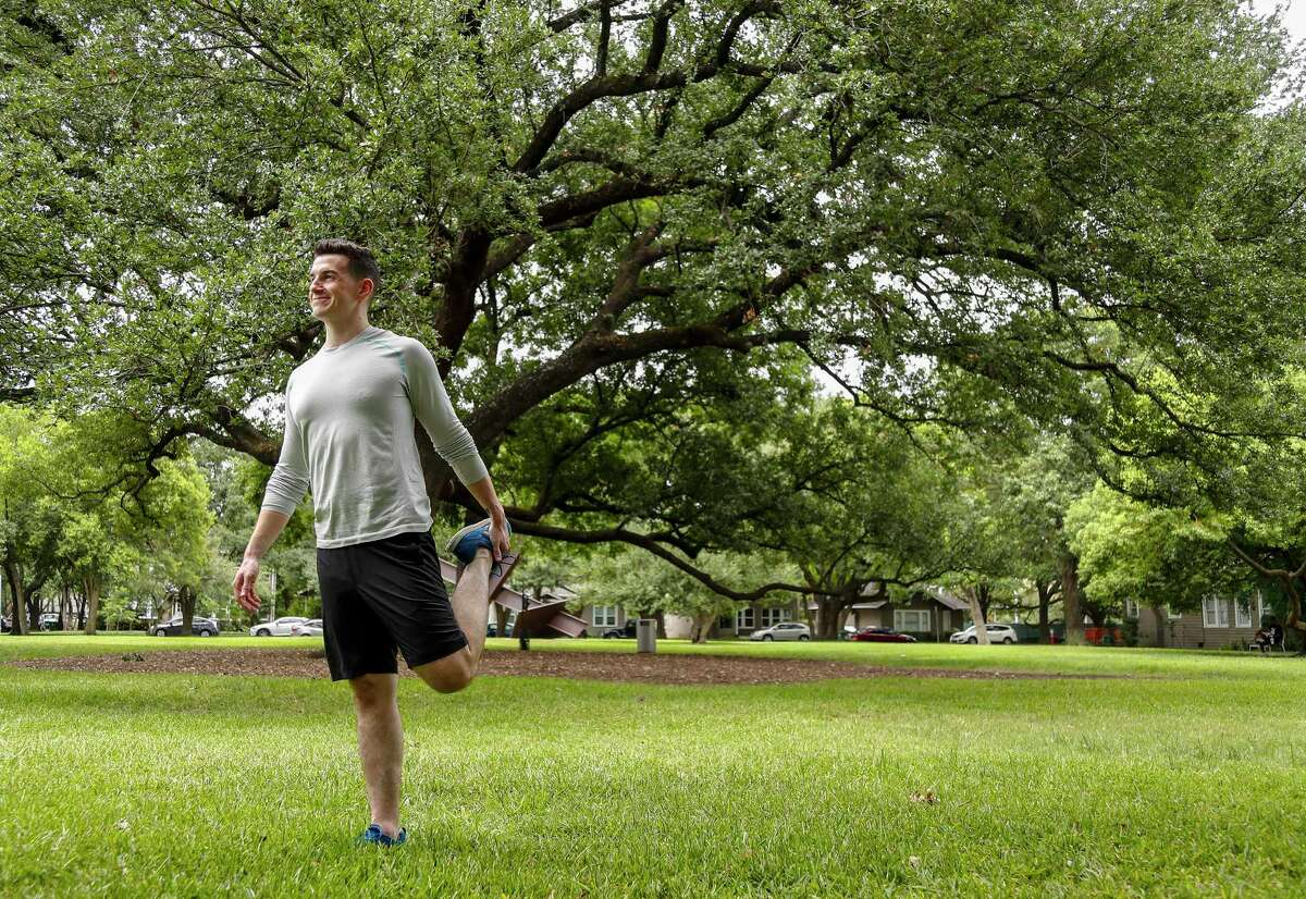 Nick Wolny stretches on the lawn near the Menil Collecion grounds, Monday, July 29, 2019. Nick lost 100 pounds as a teen, and has been living healthy ever since. His weight loss gave him the confidence to become a yoga instructor and spin teacher, then to go on into a career in marketing.