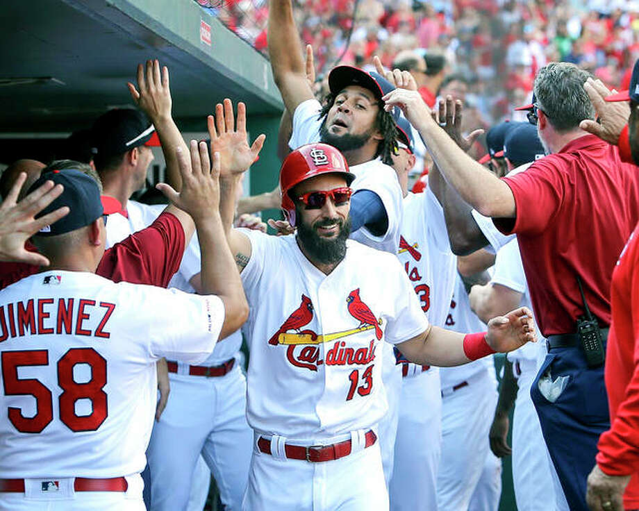 The Cardinals' Matt Carpenter, center, is congratulated by teammates after hitting a three-run home run in the third inning of Sunday's NL Central-clinching win over against the Cubs Sunday in St. Louis. Photo: Scott Kane | AP Photo