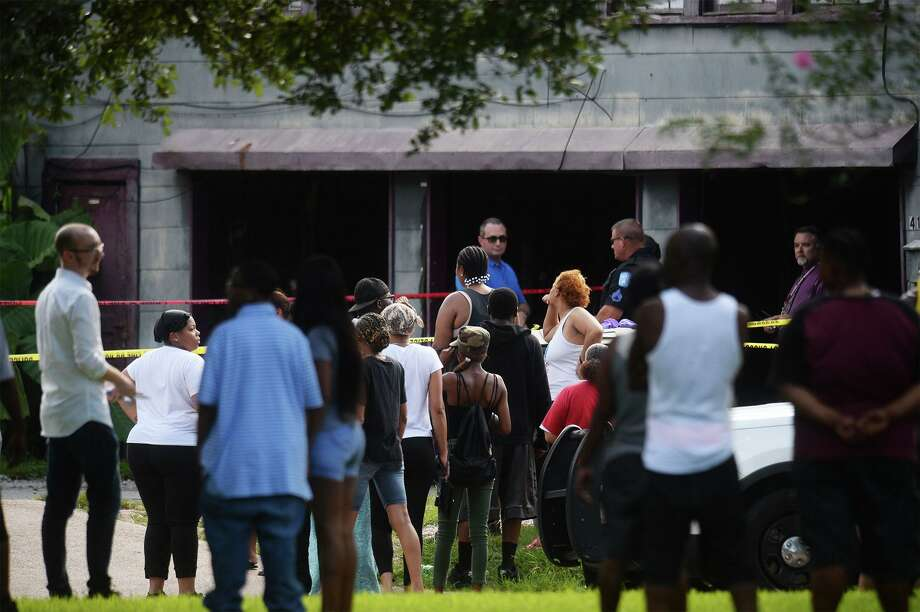 Beaumont Police investigate the shooting deaths of four people at a home at the intersection of Highland Avenue and Lavaca Street Sunday afternoon. Friends and family members of the victims gathered across the street for several hours after the shooting.  Photo taken Sunday, 9/29/19 Photo: Guiseppe Barranco/The Enterprise, Photo Editor / Guiseppe Barranco ©