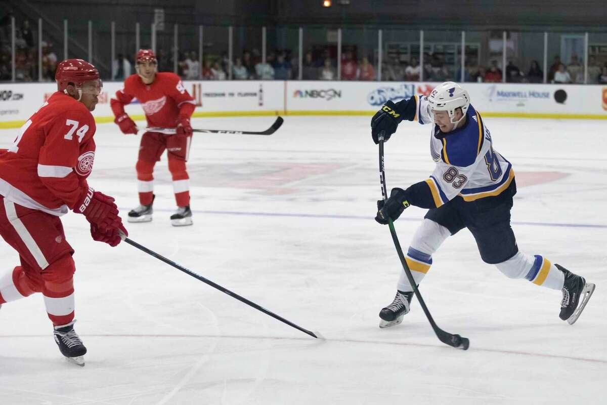 St. Louis Blues forward Tanner Kaspick (83) shoots during a preseason NHL hockey game as Detroit Red Wings defenseman Madison Bowey (74) attempts to block the shot on Thursday, Sept. 26, 2019, during an NHL hockey preseason game in Calumet, Mich. The Blues will play the Washington Capitals in the first game of the 2019-20 season, on Oct. 2, 2019.