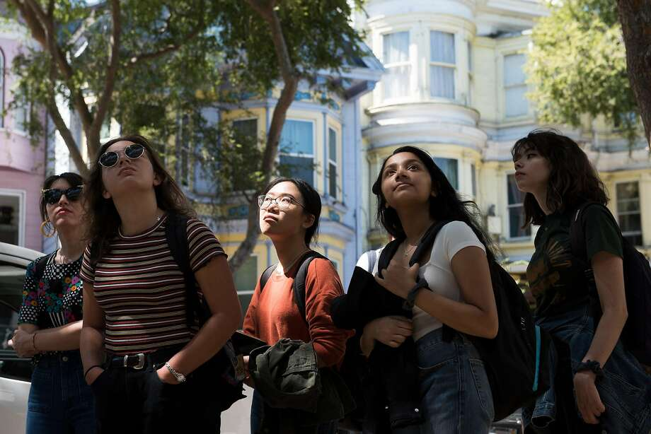 Students of University of San Francisco Professor Sergio De La Torre, who has studied the significance of the color shift, tour the Mission District with their professor. Photo: Kate Munsch / Special To The Chronicle