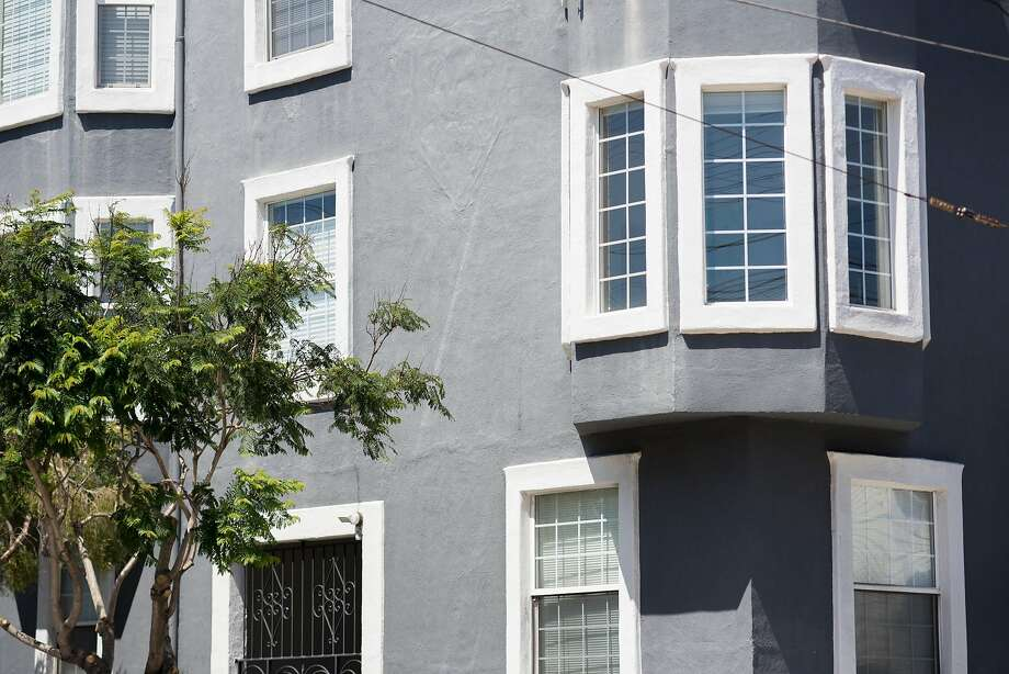 A three-story building in the Mission District shows the trend of gray-painted houses. Photo: Kate Munsch / Special To The Chronicle