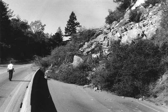 A landslide caused the Loma Prieta earthquake would block southbound lanes  Interstate Highway 17 across the Santa Cruz Mountains, October 18, 1989