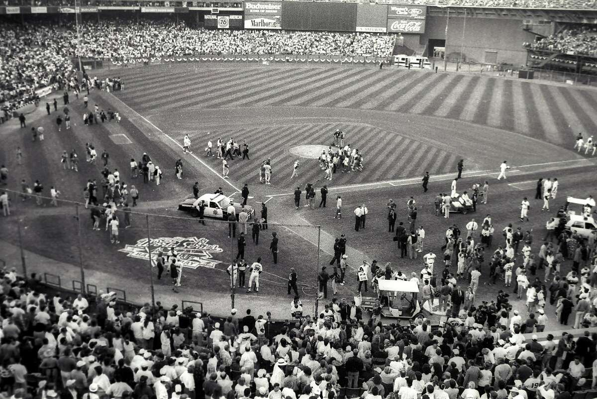 San Francisco Police and baseball officials gather to discuss what to do in the moments following the Loma Prieta Earthquake during game 3 of the World Series on October 17, 1989, at Candlestick Park.