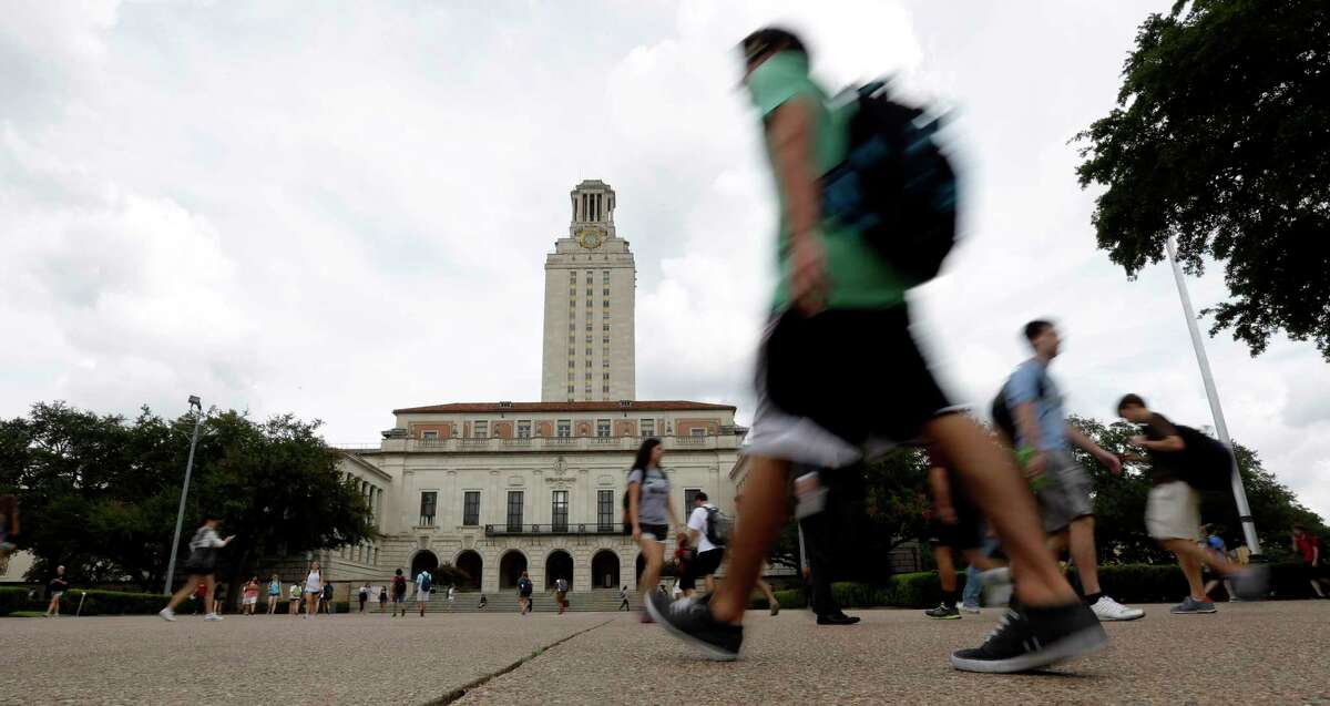 Texas students walk past the university's iconic tower, Thursday, Sept. 27, 2012, in Austin. (AP Photo/Eric Gay)