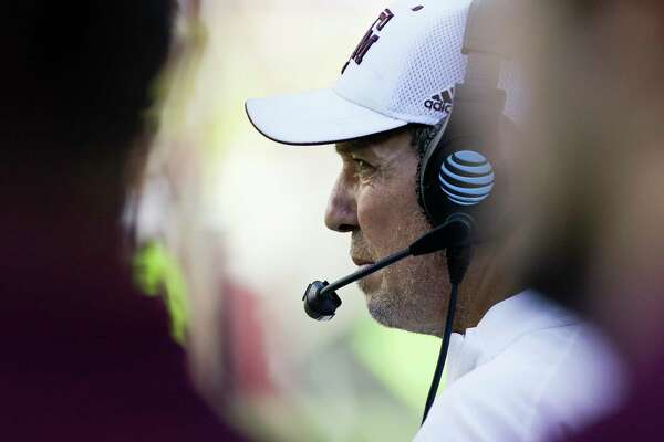 Texas A&M head coach Jimbo Fisher spending most of his time on the phone these days.