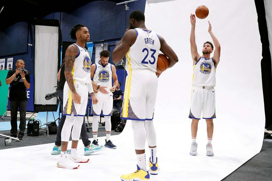 Golden State Warriors' DeAngelo Russell, Stephen Curry, Draymond Green and Klay Thompson during media day at Chase Center in San Francisco, Calif., on Monday, September 30, 2019.