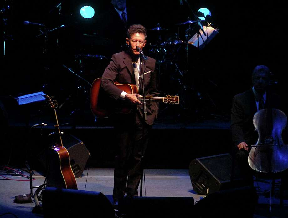 Texas-born singer-songwriter Lyle Lovett performs at the Lutcher Theater in Orange, the first leg of his tour featuring the Large Band, a collective of more than a dozen musicians. Beth Rankin/The Enterprise / Beaumont