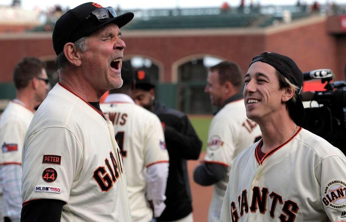 Giants manager Bruce Bochy shares a laugh with Tim Lincecum followning an onfield ceremony honoring Bochy after managed his final game with the San Francisco Giants at Oracle Park in San Francisco, Calif., on Sunday, September 29, 2019.