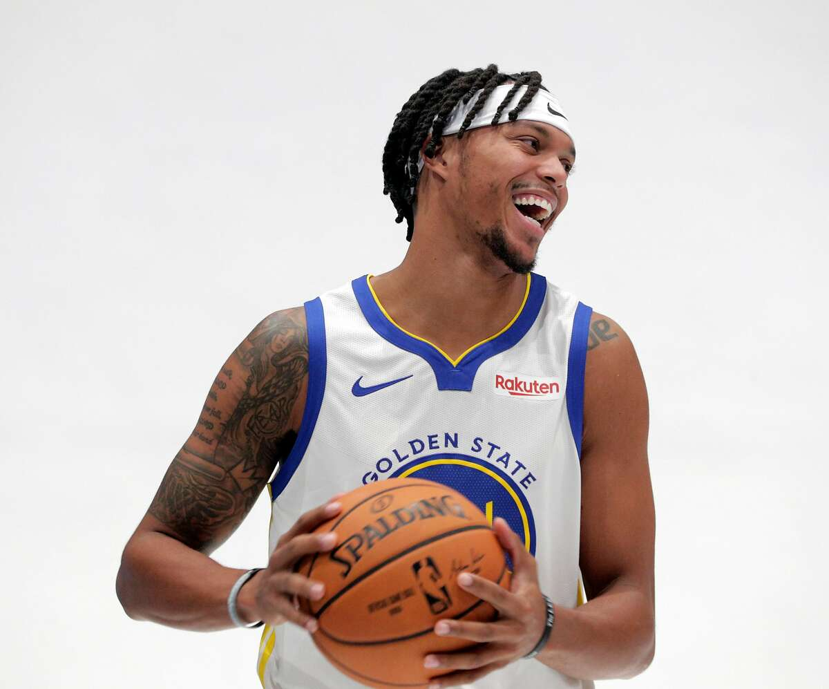 Damion Lee (1) laughs during a portrait session for media day for the Golden State Warriors at Chase Arena in San Francisco, Calif., on Monday, September 30, 2019.