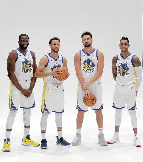 Draymond Green (23) Stephen Curry (30), Klay Thompson (11) and D'Angelo Russell (0) during media day for the Golden State Warriors at Chase Arena in San Francisco, Calif., on Monday, September 30, 2019.