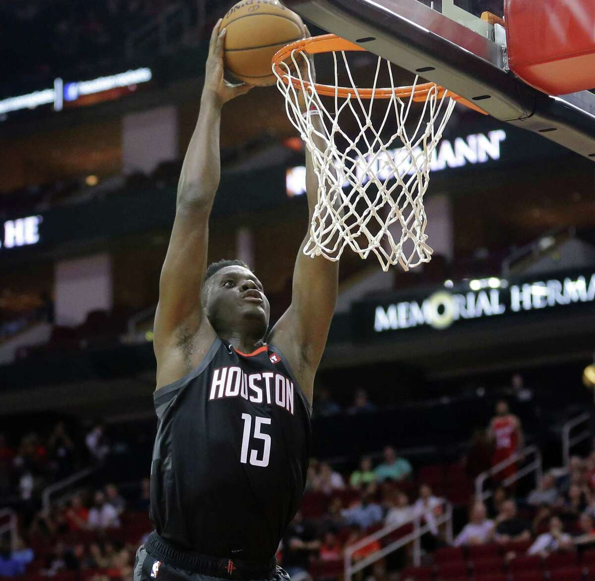 HOUSTON, TEXAS - SEPTEMBER 30: Clint Capela #15 of the Houston Rockets dunks against the Shanghai Sharks during the second quarter at Toyota Center on September 30, 2019 in Houston, Texas. NOTE TO USER: User expressly acknowledges and agrees that, by downloading and/or using this photograph, user is consenting to the terms and conditions of the Getty Images License Agreement.