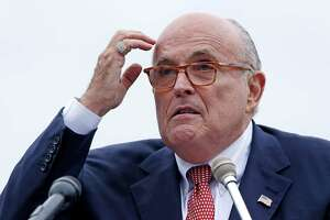 FILE - In this Aug. 1, 2018 file photo, Rudy Giuliani, attorney for President Donald Trump, addresses a gathering during a campaign event in Portsmouth, N.H. House committees have subpoena Giuliani for documents related to Ukraine. (AP Photo/Charles Krupa, File )