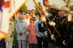 The family of Harris County Deputy Sandeep Dhaliwal watches as an honor guard begins a vigil to honor Deputy Dhaliwal at Harris County Deputy Darren Goforth Park in northwest Houston, Monday, Sept. 30, 2019.