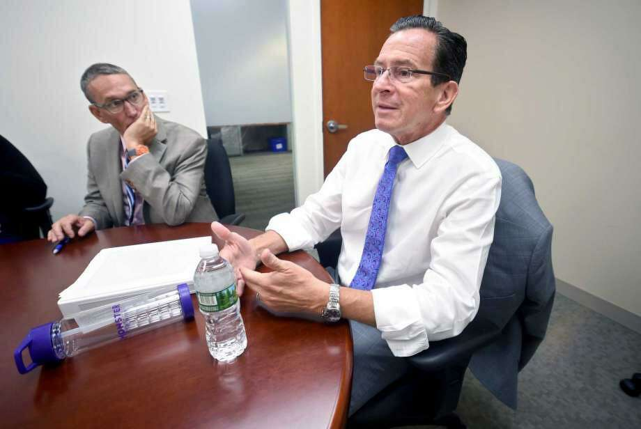 Former Gov. Dannel Malloy is shown with his budget chief, Ben Barnes. Photo: Hearst Connecticut Media