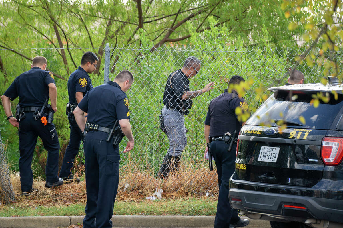 San Antonio Police Department investigators approach a homeless camp where a man was found dead at about 5 p.m. on Monday, September 30, 2019, in the 2500 block of Southwest Military Drive.