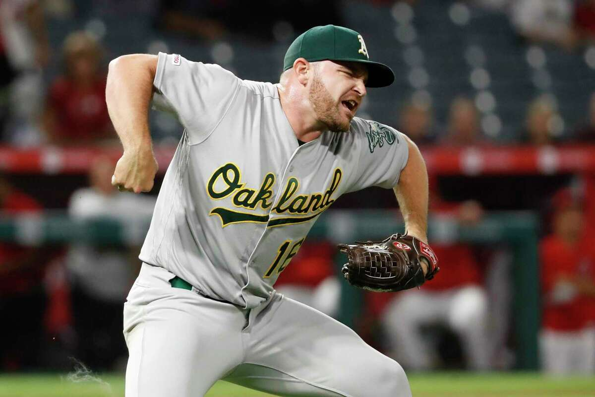 Closer Liam Hendriks is one of several Athletics pitchers who've gotten fired up this season over the elite defense being played behind him, especially when he needs help to get out of a tight jam.