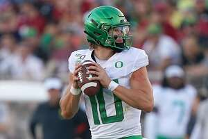 PALO ALTO, CA - SEPTEMBER 21:  Justin Herbert #10 of the Oregon Ducks drops back to pass against the Stanford Cardinal during the fourth quarter of an NCAA football game at Stanford Stadium on September 21, 2019 in Palo Alto, California.  (Photo by Thearon W. Henderson/Getty Images)