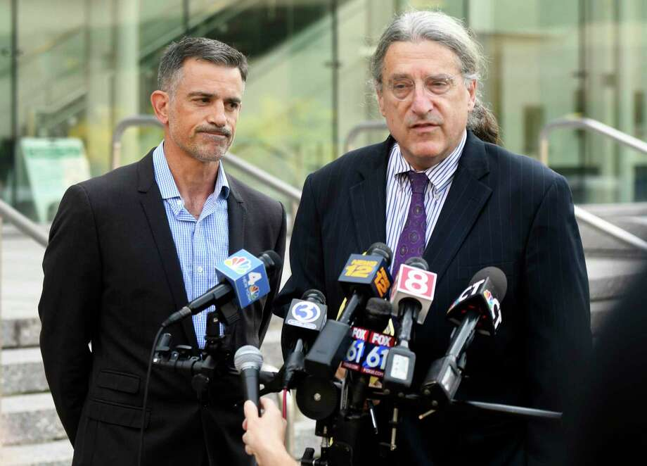 Fotis Dulos, left, listens as his attorney Norm Pattis address the media after appearing at the Connecticut Superior Court in Stamford, Conn., Monday, Sept. 23, 2019. Photo: Tyler Sizemore / Hearst Connecticut Media / Greenwich Time