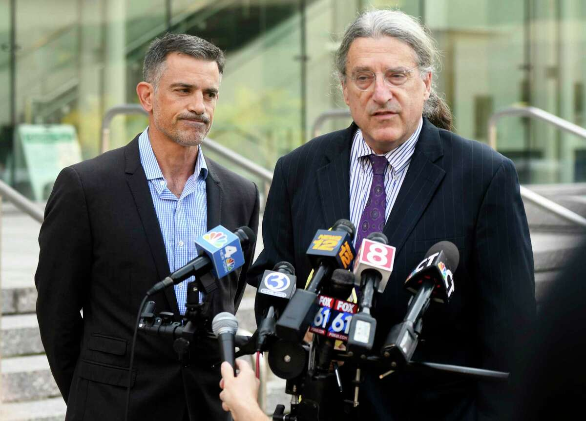 Fotis Dulos, left, listens as his attorney Norm Pattis addresses the media after appearing at the Connecticut Superior Court in Stamford, Conn., Monday, Sept. 23, 2019.