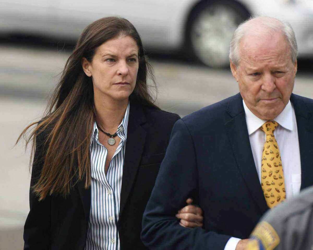 Michelle Troconis, charged in connection with the disappearance of Jennifer Dulos, enters the Connecticut Superior Court in Norwalk, Conn. with her father, Carlos Troconis on Wednesday, Sept. 18, 2019.