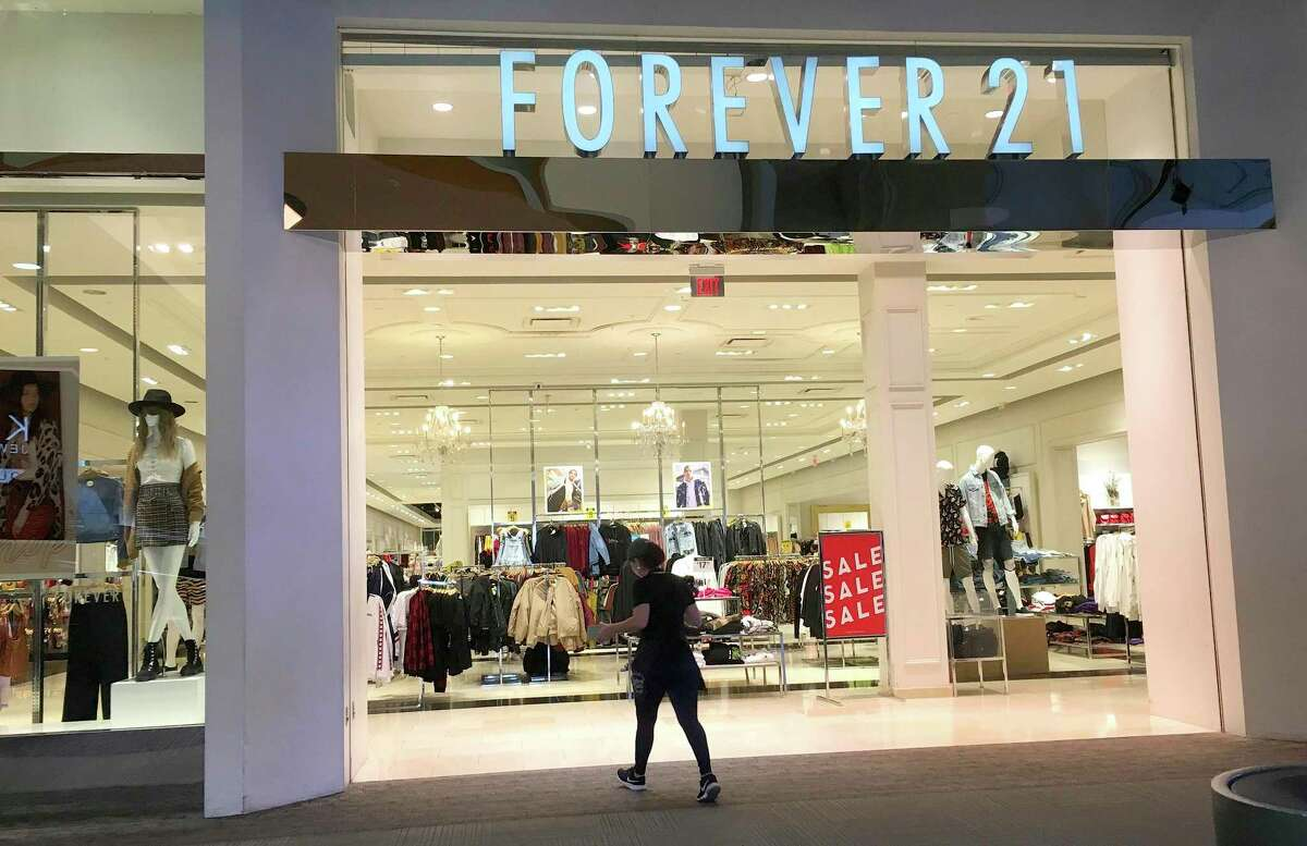 A shopper walks into a Forever 21 clothing store, Monday, Sept. 30, 2019, in Tempe, Ariz. Low-price fashion chain Forever 21, a one-time hot destination for teen shoppers that fell victim to its own rapid expansion and changing consumer tastes, has filed for Chapter 11 bankruptcy protection. (AP Photo/Ross D. Franklin)