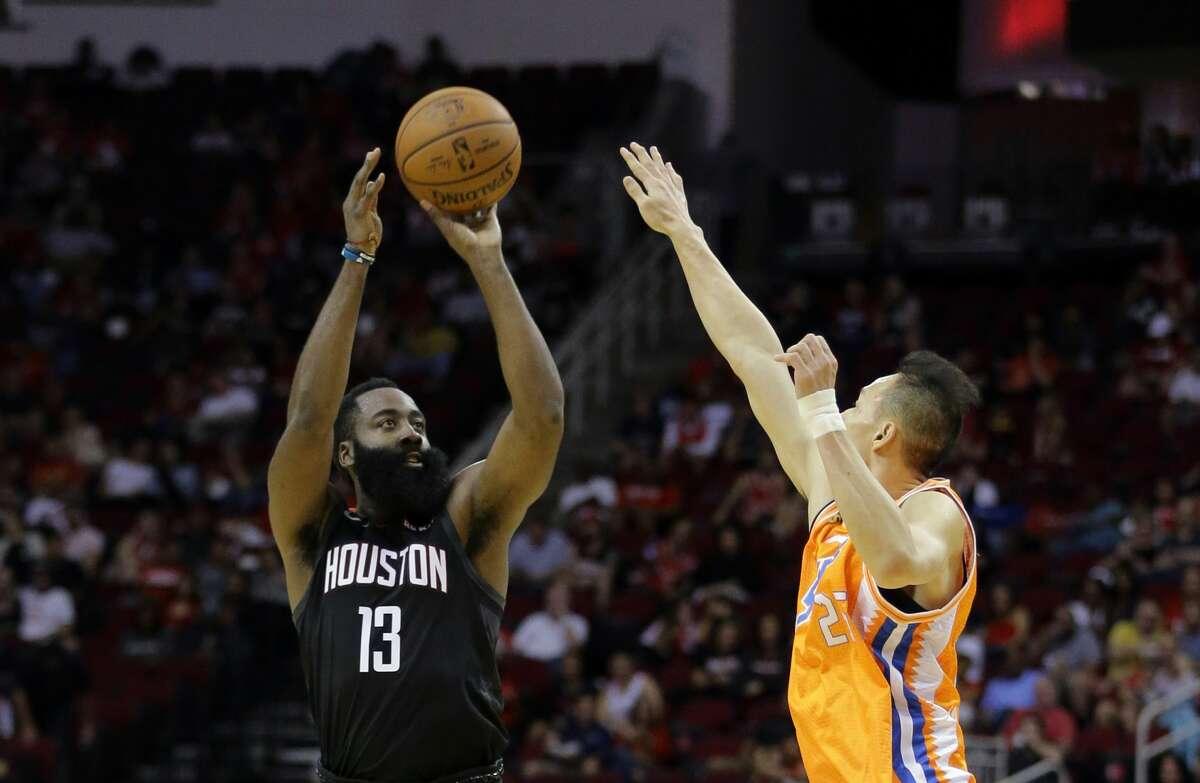 HOUSTON, TEXAS - SEPTEMBER 30: James Harden #13 of the Houston Rockets shoots a three-pointer over Wang Tong #25 of the Shanghai Sharks during the second quarter at Toyota Center on September 30, 2019 in Houston, Texas. NOTE TO USER: User expressly acknowledges and agrees that, by downloading and/or using this photograph, user is consenting to the terms and conditions of the Getty Images License Agreement. (Photo by Bob Levey/Getty Images)