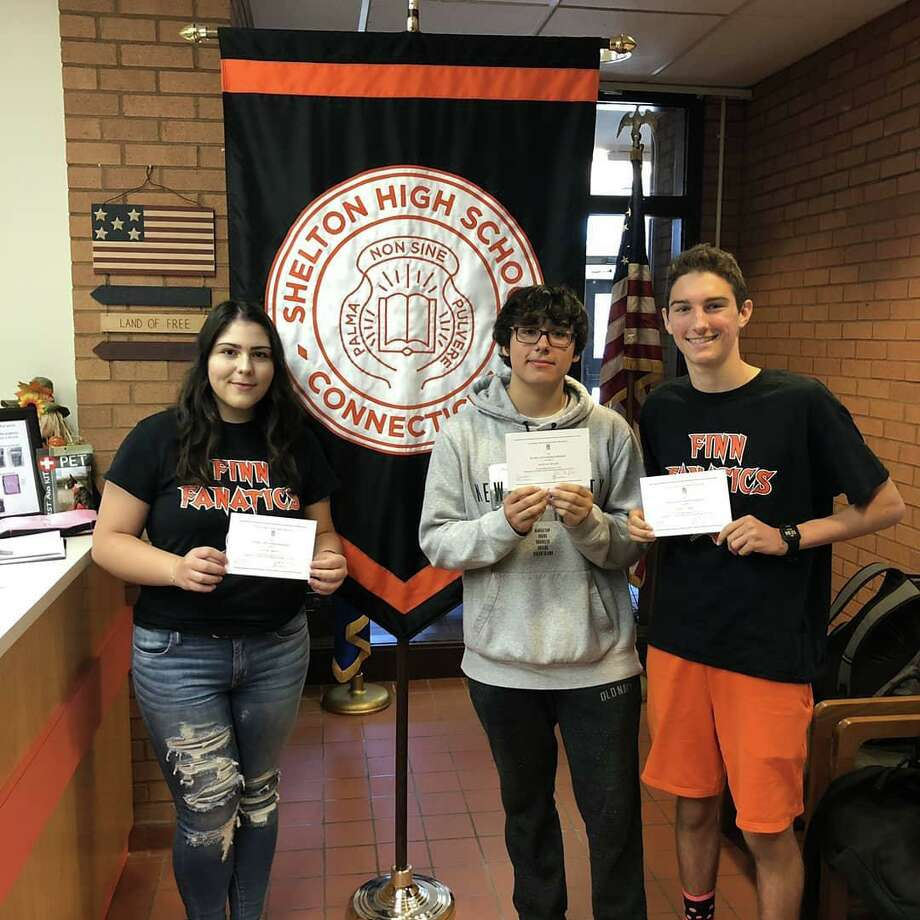 Shelton High School students Rachel Brown, Dustin Keller, center, and Owen Corbett were recently honored as National Merit Commended Students. Photo: Contributed Photo / Connecticut Post