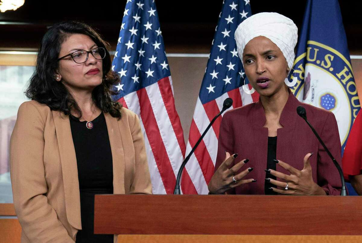 U.S. Rep. Ilhan Omar, D-Minn, right, speaks, as U.S. Rep. Rashida Tlaib, D-Mich. listens, during a news conference at the Capitol in Washington.