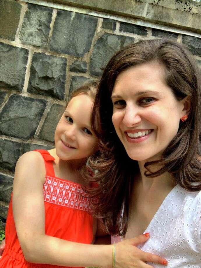 Dr. Jaime Ruskowski holds her daughter, Adrienne, who suffers multiple food allergies. Ruskowski Photo: Contributed Photo / New Canaan Advertiser Contributed