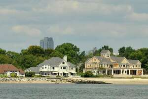 Stamford, Conn., homes on Shippan Point can be seen on the shore of the Long Island Sound Stamford, Conn., on Thursday, Aug. 27, 2015.
