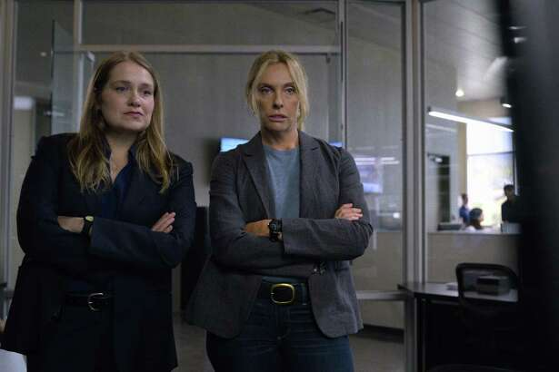 """Merritt Wever (left) and Toni Collette play detectives investigating a serial rape case in Colorado in Netflix's limited series """"Unbelievable."""""""