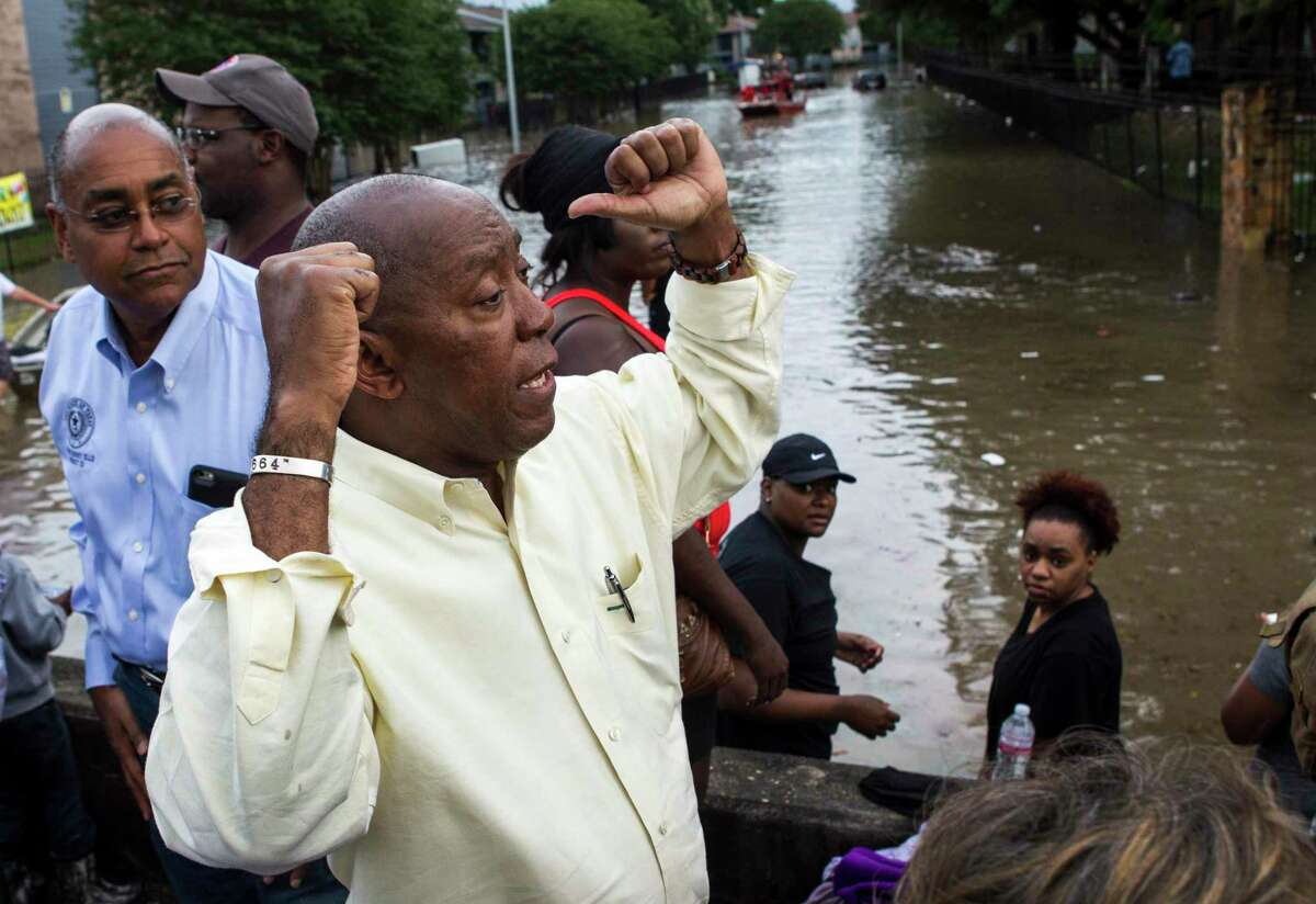 Mayor Sylvester Turner visits the flooded Arbor Court apartment complex as it is evacuated in the Greenspoint area on Monday, April 18, 2016, in Houston. ( Brett Coomer / Houston Chronicle )