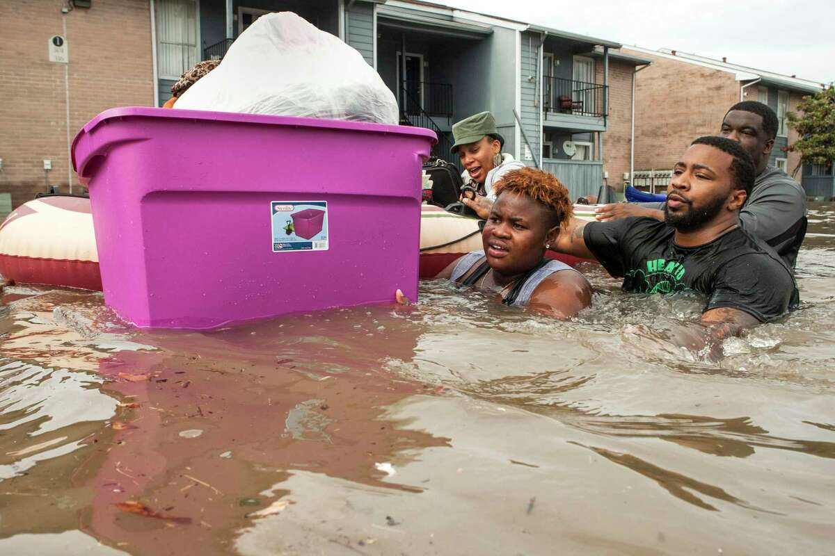 Residents of the Arbor Court apartments evacuate their flooded apartment complex in the Greenspoint area on Monday, April 18, 2016, in The Woodlands, Texas.