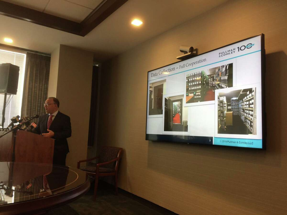 Judge Robert Holzberg shows photographs of the Roman Catholic Diocese of Bridgeport's secret archives in a press conference about an investigative report on sexual abuse cases in the diocese released on Tuesday, Oct. 1, 2019.