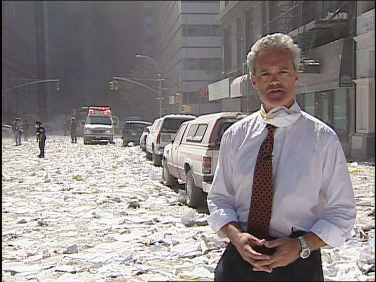 """Scott Pelley reporting from Ground Zero for CBS after the attacks on the World Trade Center on Sept. 11, 2001. Pelley will discuss his career and his memoir, """"Truth Worth Telling,"""" at Wilton Library on Oct. 17."""