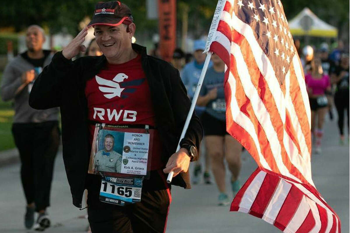 Michael Murphy, 46, runs races carrying an American flag in honor of living veterans and fallen soldiers. He will run the Houston Marathon in January 2020.